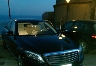 black sedan Mercedes of the Positano Car Service Car Park