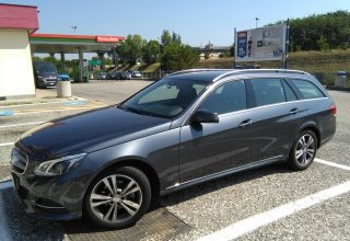 Grey Mercedes of the Positano Car Service's Car Park